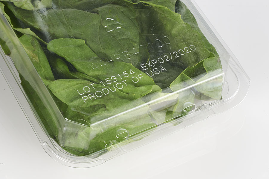 Best by and lot code on plastic clamshell packaging for produce made with MMS laser