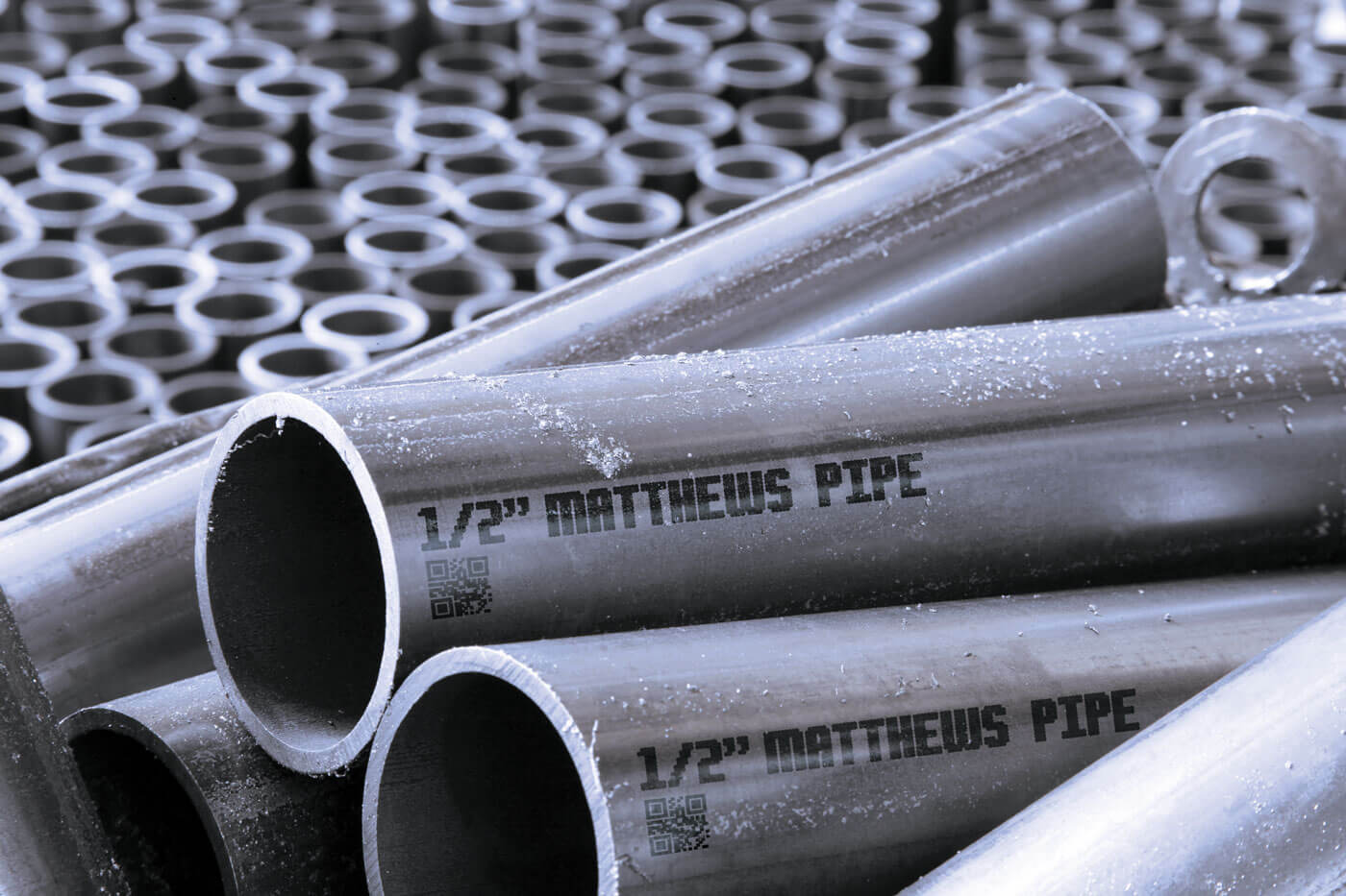 Steel pipe with large character human readable text and 2D code using V-Series marking machine