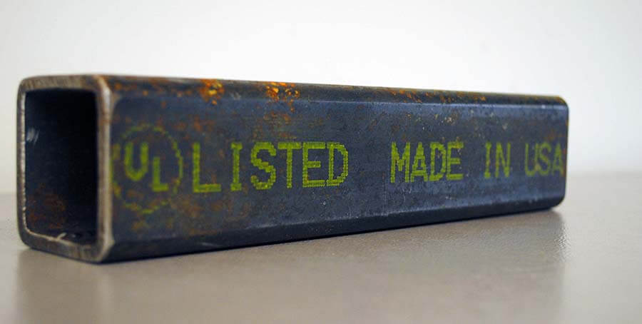 Metal pipe with pigmented ink using V-Series marking machine with large character human readable text