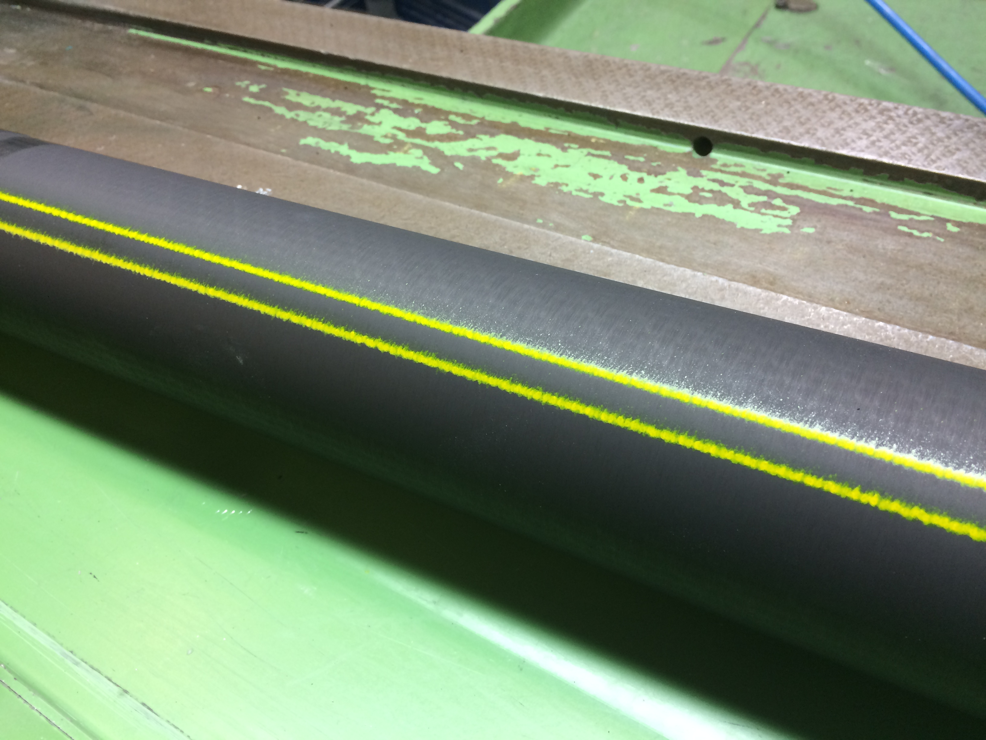 Metal pipe with pigmented ink using V-Series marking machine for striping