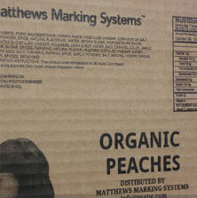 Barcode, graphics, and variable data printed on corrugated cardboard carton by a Matthews Marking System
