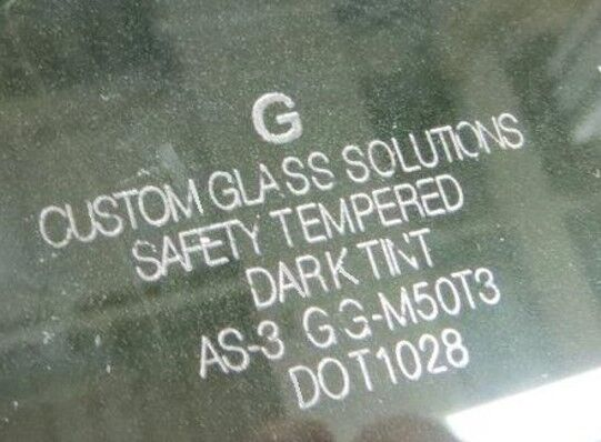 Laser mark on clear glass