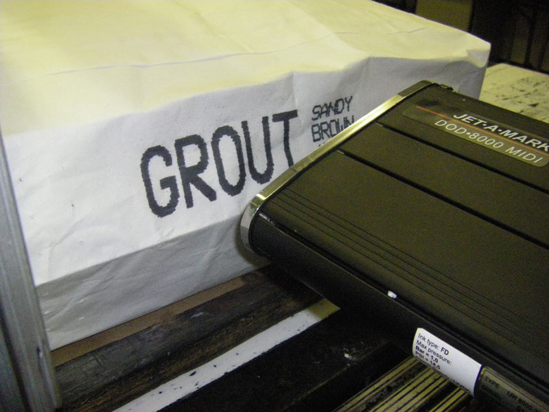 drop-on-demand inkjet marking system printing mark and code on grout or concrete paper bag