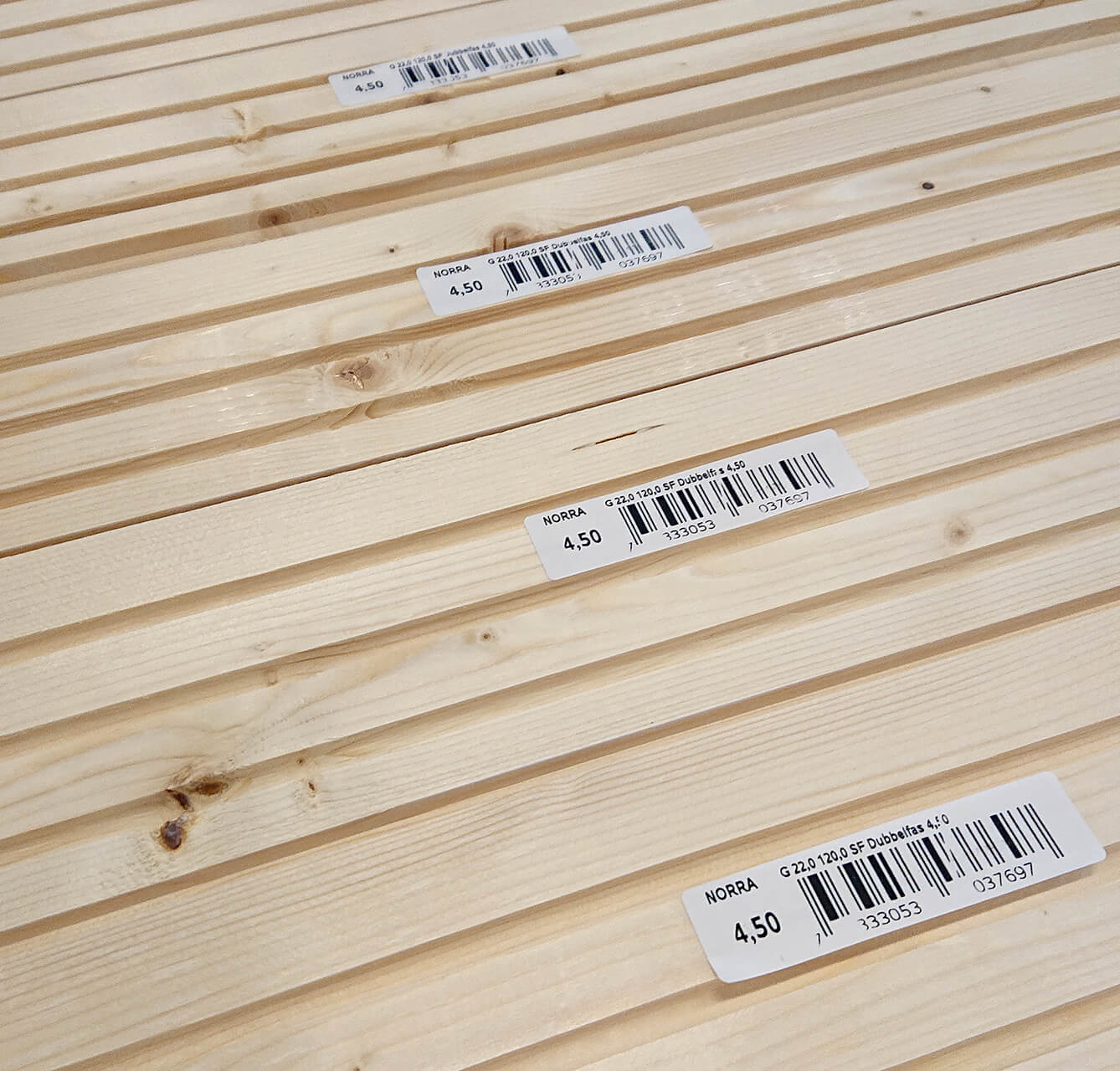 Barcode label on stick lumber with MMS A-Series label machine