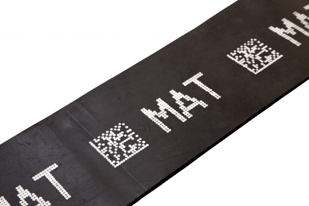 Rubber mat with human readable text and 2D code made with V-Series drop-on-demand marking system