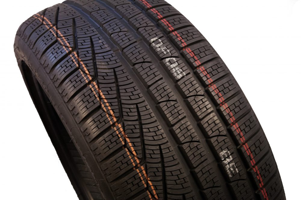 Rubber tire with striping and human readable text mark made by pigmented ink and valve jet