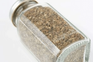 Glass spice jar with aluminum cap with lot code and expiry date, mark produced by a Matthews Marking System