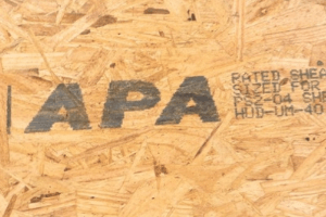 Plywood/ oriented strand board (OSB) with APA mark on it. Mark made with MMS marking system.